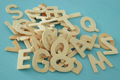 Set of a wooden letters of the English alphabet. On wooden blue background Royalty Free Stock Photo