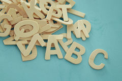 Set of a wooden letters of the English alphabet. On wooden blue background Royalty Free Stock Photos