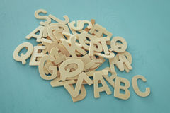 Set of a wooden letters of the English alphabet. On wooden blue background Royalty Free Stock Images