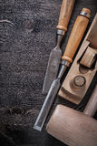 Set of wooden mallet metal chisels planer on wood. Board Stock Photo