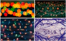 Set of wooden numbers forming the number 2018 and Christmas ligh stock image