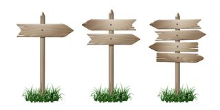 Set of wooden signpost. With arrows in grass isolated on white background. Vector illustration Royalty Free Stock Photo