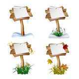 Set of wooden signs in four seasons. Royalty Free Stock Photo