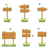 Set of wooden signs in grass Royalty Free Stock Photo