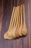 Set of wooden spoon on wooden background Royalty Free Stock Photo