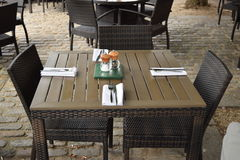 Set wooden table with two chairs ready for lunch in the best business District Stock Photography