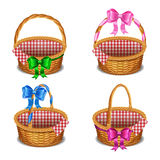 Set of wooden wicker baskets with bows, isolated on a white Stock Image