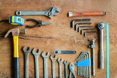 Set of work tools on old grunge wood background. With copy space Royalty Free Stock Image