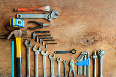 Set of work tools on old grunge wood background. With copy space Stock Image