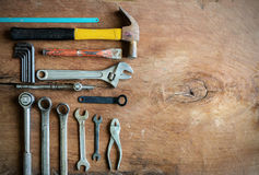 Set of work tools on old grunge wood. Background with copy space Royalty Free Stock Image