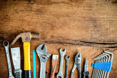 Set of work tools on old grunge wood background. Top view Stock Photo