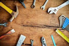 Set of work tools on old grunge wooden background Royalty Free Stock Photo