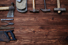 The set of workers vintage worn working hand tools. Working hand tools carpenter isolated on grunge wooden background Stock Photos