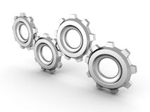 Set of working connected metallic cogwheel gears Stock Photo