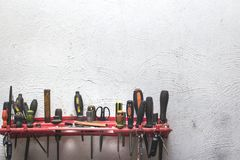 A set of working construction tools on a white plastered wall stock images