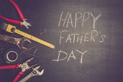 Set of working tools on black background. A concept for Father`s Day. Top view. Flat laying stock photos