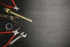 Set of working tools on black background. A concept for Father`s Day. Top view. Flat laying stock photography