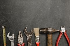 Set of working tools on black background. A concept for Father`s Day. Top view. Flat laying stock photo