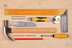 Set of working tools for carpentry works on the wooden table Royalty Free Stock Photos