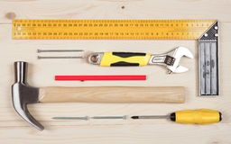 Set of working tools for carpentry works on the wooden table Royalty Free Stock Images