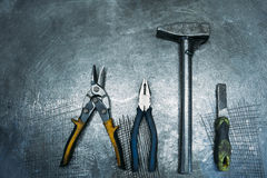 Set working tools lying on metal table Royalty Free Stock Image
