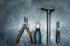 Set working tools lying on metal table. Top view of set working tools lying on metal table Royalty Free Stock Image