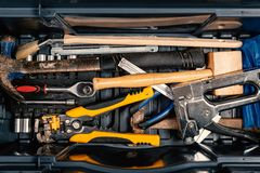 Set of working tools in tool box, top view. Do it yourself. Set of working tools in tool box, top view. DIY theme toolbox equipment hammer pliers wire stripper stock photography