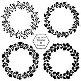 Set of 4 wreaths with black barries and leaves royalty free illustration