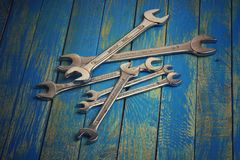 Set of wrenches. On the blue wooden table Royalty Free Stock Photos