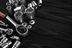 Set of wrenches, bolts and nuts on a wooden background. Close up Stock Images