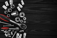 Set of wrenches, bolts and nuts on a wooden background. Stock Photo