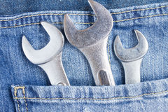 Set of wrenches in jeans pocket Royalty Free Stock Photo