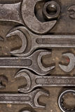 Set of wrenches on oiled floor of the garage Stock Photography