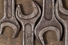 Set of wrenches on oiled floor of the garage Stock Image