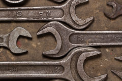 Set of wrenches on oiled floor of the garage Royalty Free Stock Photo