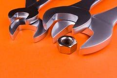 Set of  wrenches on a orange background. Stock Photo