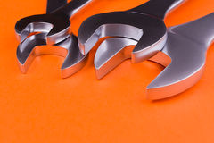 Set of  wrenches on a orange background. Royalty Free Stock Photography