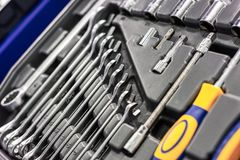 A set of wrenches in a plastic box. A set for car repair. Close-up photo. Set of tools for car repair in box, top viewA set of wrenches in a plastic box. A set royalty free stock images
