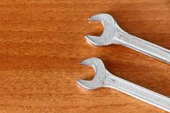 Two wrenches on a wooden background. royalty free stock images
