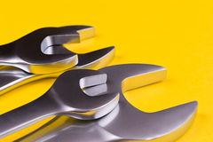 Set of  wrenches on a yellow background. Stock Photos