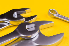 Set of  wrenches on a yellow background. Royalty Free Stock Images