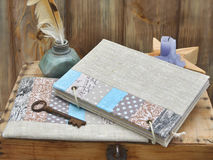 Set the writer for creativity and handmade: a notebook turquoise craft patchwork, textile pencil case, vintage feather royalty free stock images