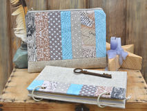 Set the writer for creativity and handmade: a notebook turquoise craft patchwork, textile pencil case, vintage feather Stock Images