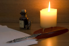 Set of writing equipment. With candle Royalty Free Stock Photography