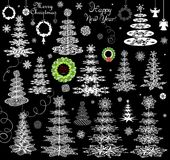 Set of xmas paper snowflakes, conifers and hanging wreath Stock Photography