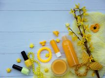 Set of  yellow accessories for young girl or teenager. Nail polishes, lipstick, hair clips, bands, beads, bracelet, perfume and fl. Set of yellow accessories for Stock Photos