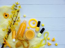 Set of  yellow accessories for young girl or teenager. Nail polishes, lipstick, hair clips, bands, beads, bracelet, perfume and fl. Set of yellow accessories for Royalty Free Stock Photography
