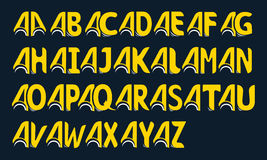 Set of yellow alphabet made of linked letters on a black background Royalty Free Stock Photo