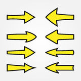 Set yellow arrows with a black stroke. Sign pointer. Stock Photos