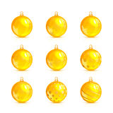 Set of yellow Christmas balls with golden pattern Stock Photo